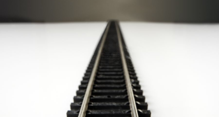 close up shot of a toy railway line going of into the distance