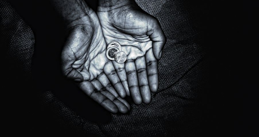 African hands with coins